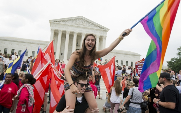 Sasha Altschuler of San Diego, Calif., joins the celebrations outside the Supreme Court in Washington, Friday, June 26, 2015 after the court declared that same-sex couples have a right to marry anywhere in the US.   (AP Photo/Manuel Balce Ceneta)